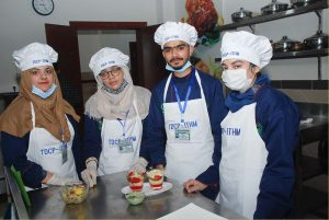 Students Working in Kitchen
